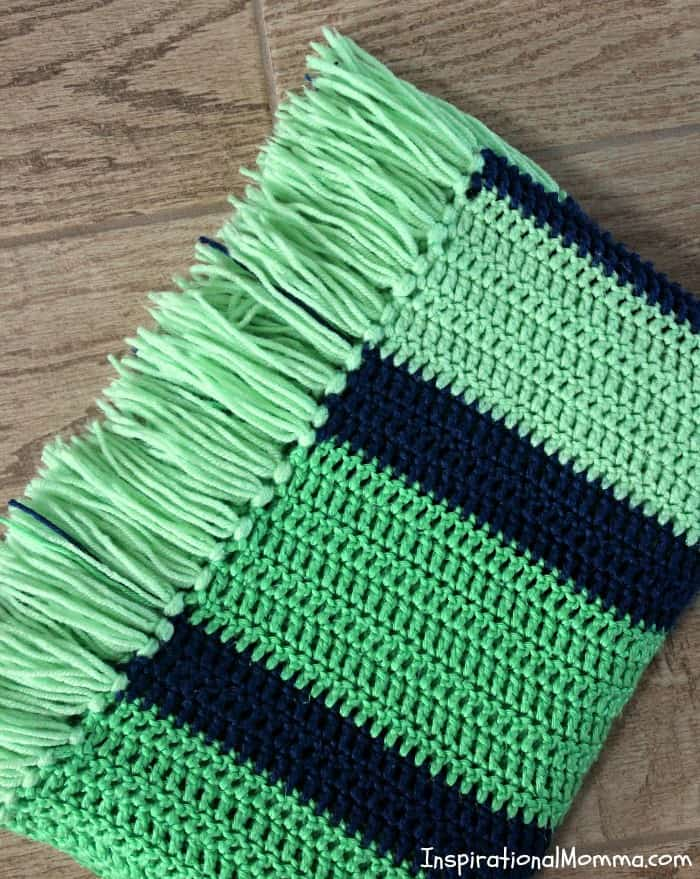 This Double Crochet Striped Blanket is a perfect project for any crocheter! Using only a double crochet stitch, it is so simple, anyone can do it! double crochet, crochet, #inspirationalmomma #homemade #diy #howtocrochet #crocheting #beginning #easy #simple