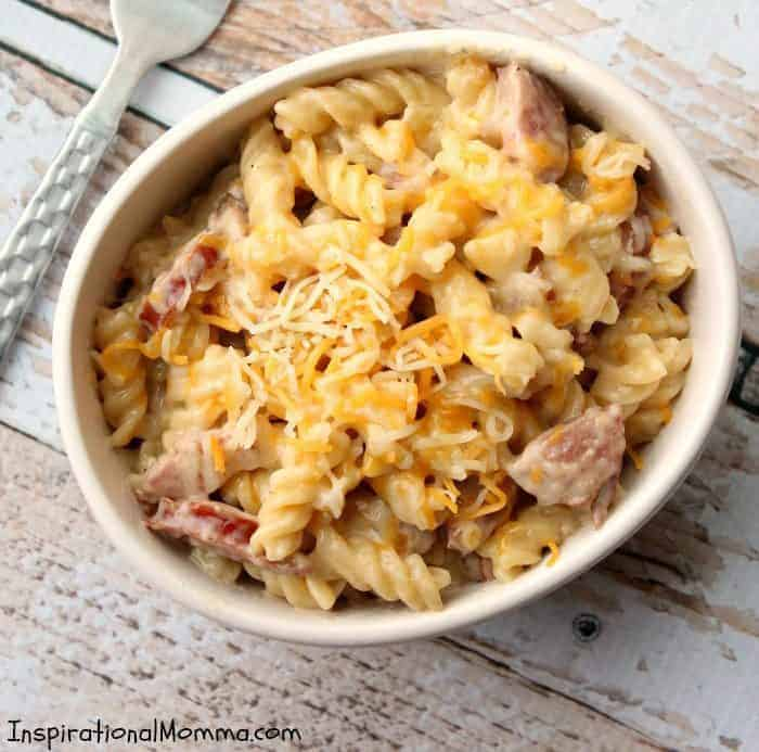 Ready in just 20 minutes, this One-Pan Cheesy Kielbasa Pasta will make everyone in your family smile! Simple and delicious! #inspirationalmomma #onepancheesykielbasapasta #onepan #kielbasa #cheesy #pasta #dinner #recipe