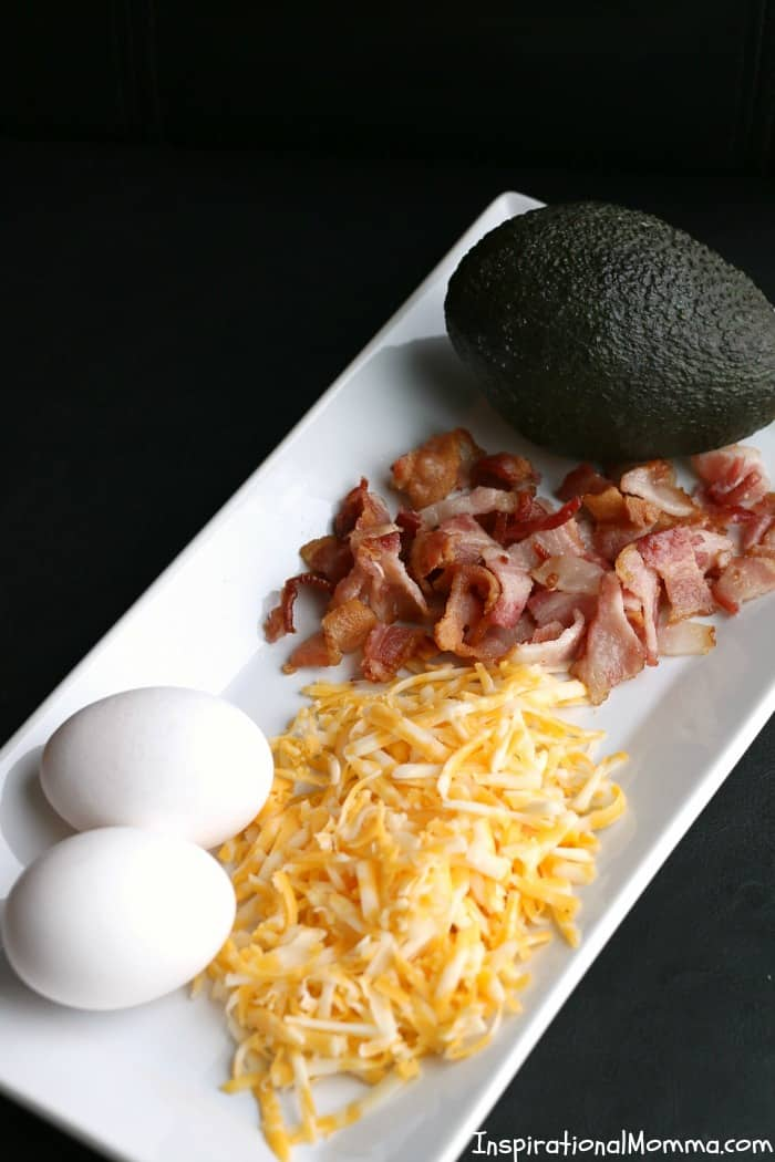Avocado Eggs with Bacon & Cheese are a quick and easy meal for any time of the day! Being low in carbs and big on flavor, you can't resist them!