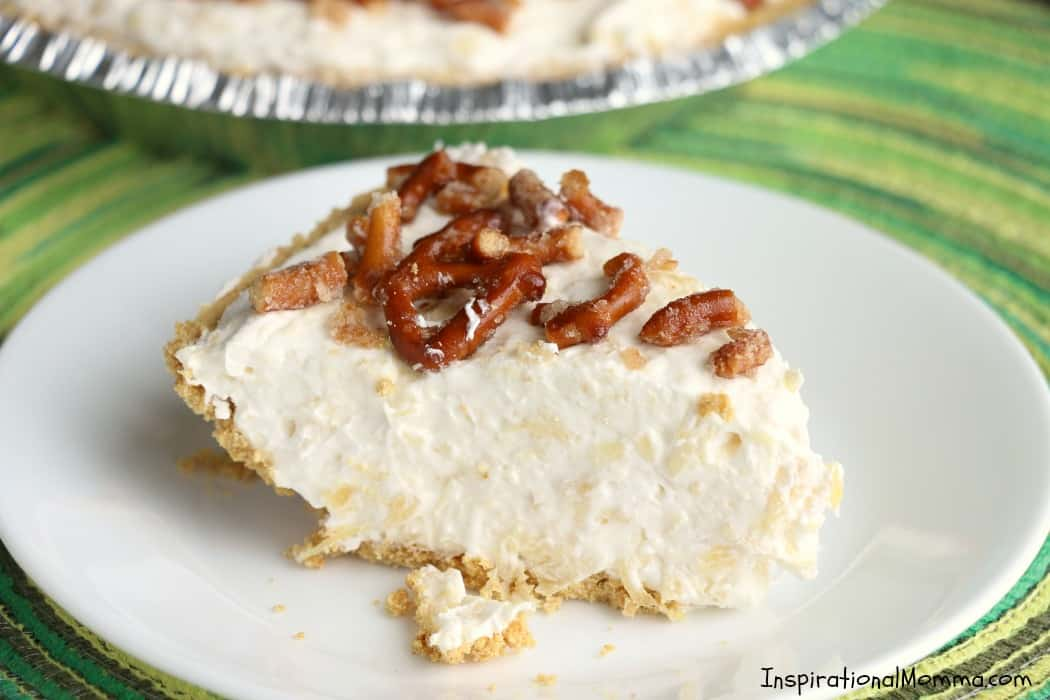 Creamy Pineapple Fluff Pie is a perfect combination of smooth and crunchy, sweet and salty. This simple pie comes together quickly and will become the talk of the party!