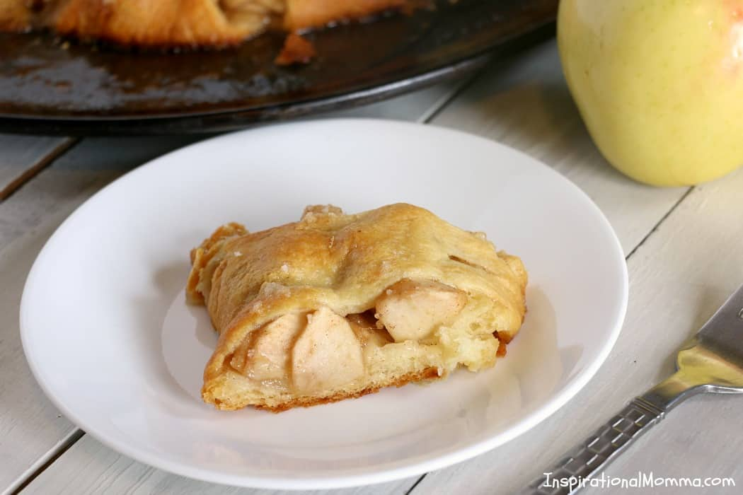This Apple Pie Crescent Ring is packed with sweet flavors of a traditional apple pie and wrapped in a light, golden crust!