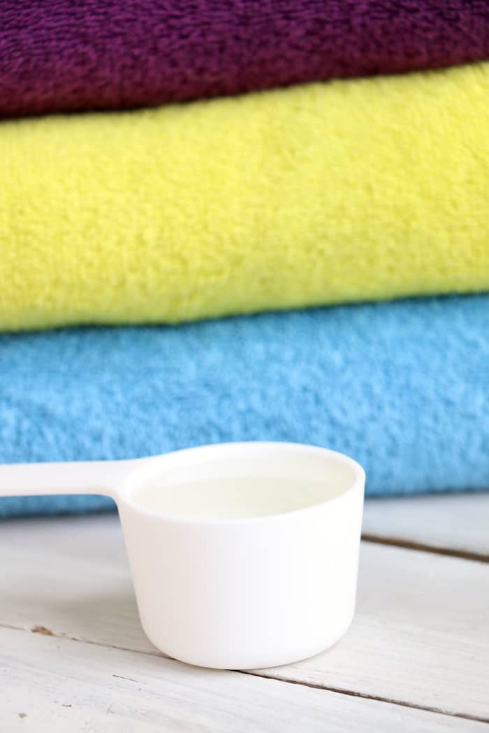 This Homemade Liquid Laundry Detergent will leave your clothes clean and smelling fresh while saving you money. Made with just 5 ingredients, it is so easy! #inspirationalmomma #homemadeliquidlaundrydetergent #laundrydetergent #homemade #diy #cleaning #cleaner #laundry #momonabudget