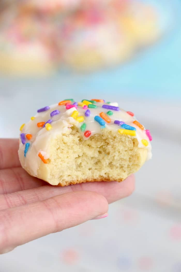 Soft Chewy Confetti Cookies are light, delicious and melt in your mouth. Covered with sweet icing and sprinkles, they are absolutely irresistible! #inspirationalmomma #confetticookies #cookies #softandchewy #recipe #dessert #desserts #cookie