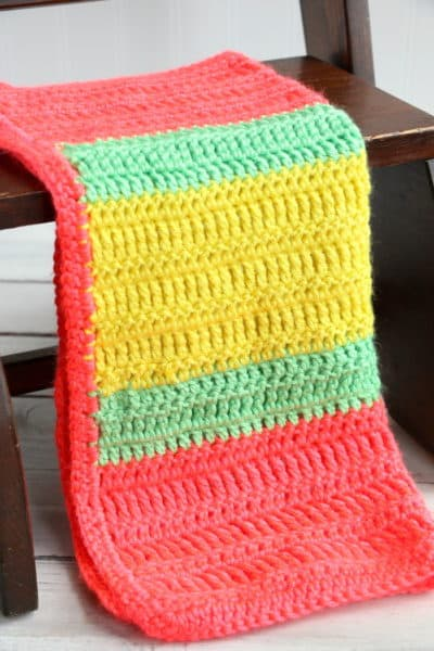 This Varied Double Crochet Triple Crochet Blanket is a perfect project for any crocheter. The stitches are simple and the colors are fun and vibrant! #InspirationalMomma #doublecrochet #triplecrochet #crochet #crochetpattern #freepattern