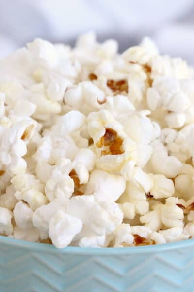 Instant Pot Popcorn in a blue bowl.