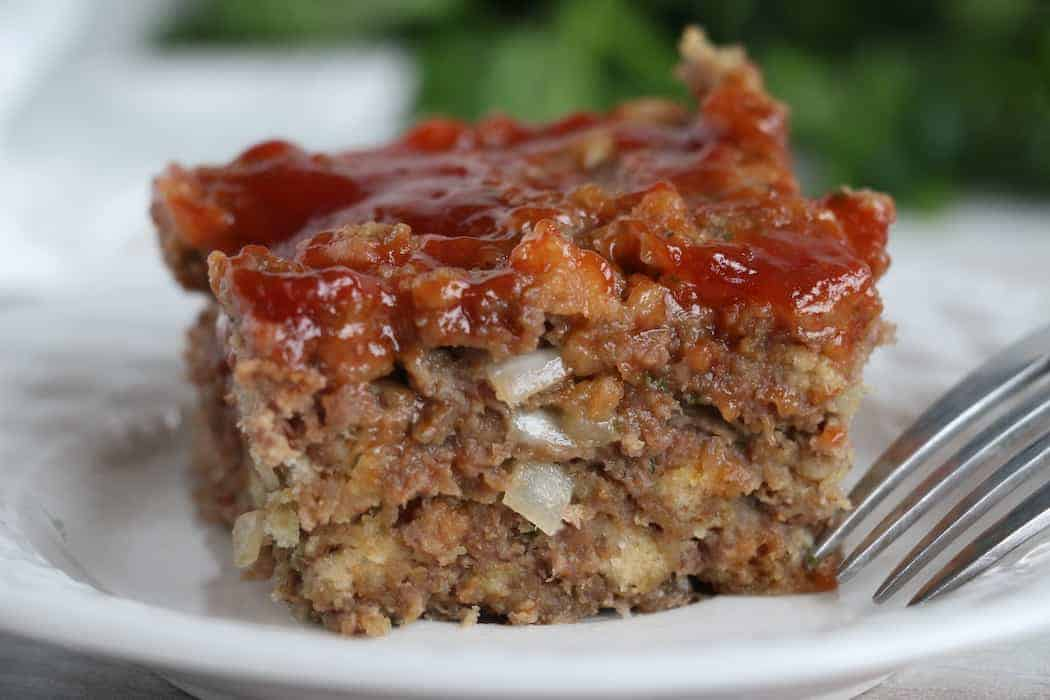 Homemade Meatloaf on a small white plate.