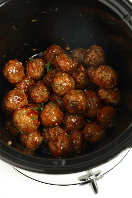 Honey garlic meatballs cooking in the crock pot.