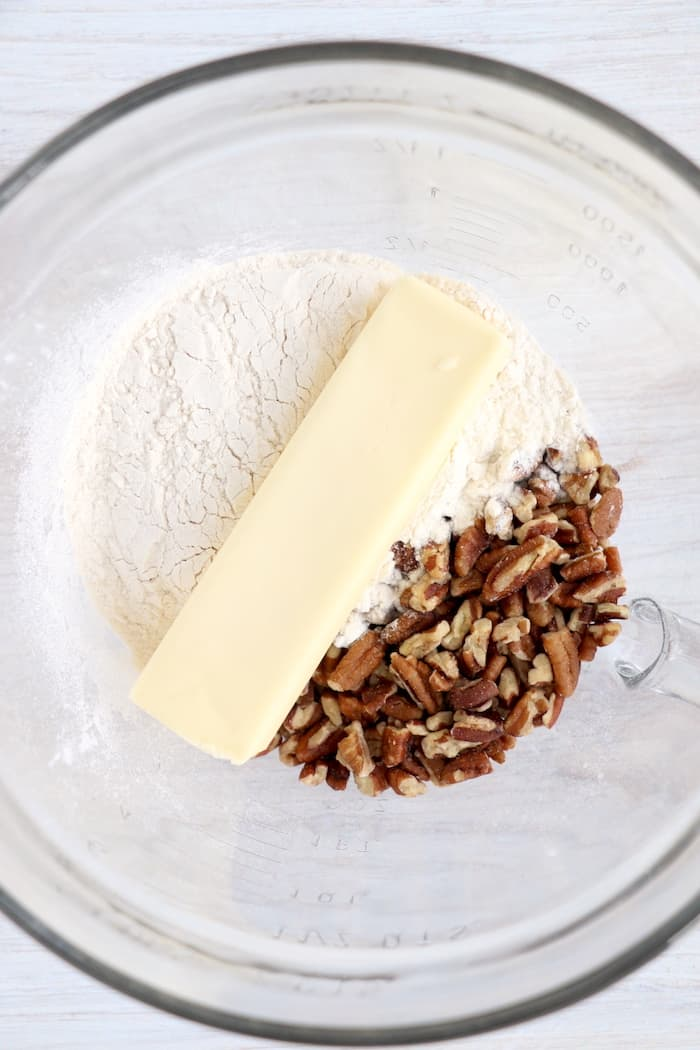 Ingredients for the crust layer in a glass bowl.