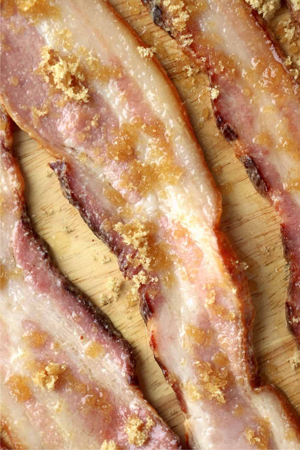 Strips of bacon with a delicious mixture of melted butter, salt and garlic powder brushed on them