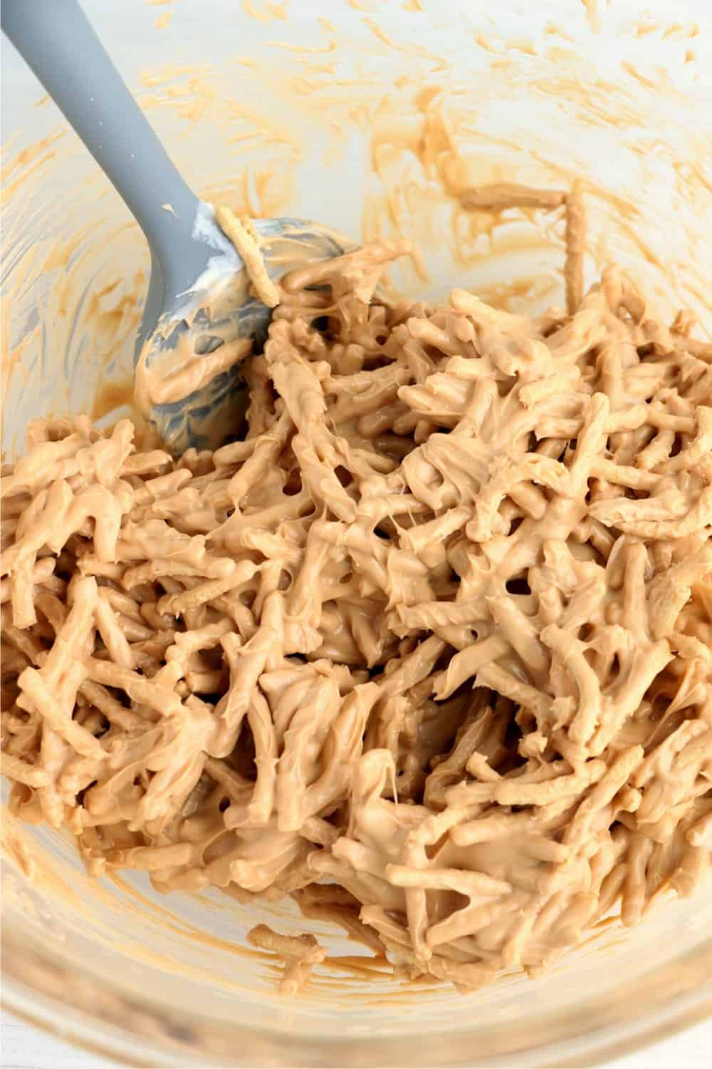 Chow mein noodles mixed into melted butterscotch chips and white bark