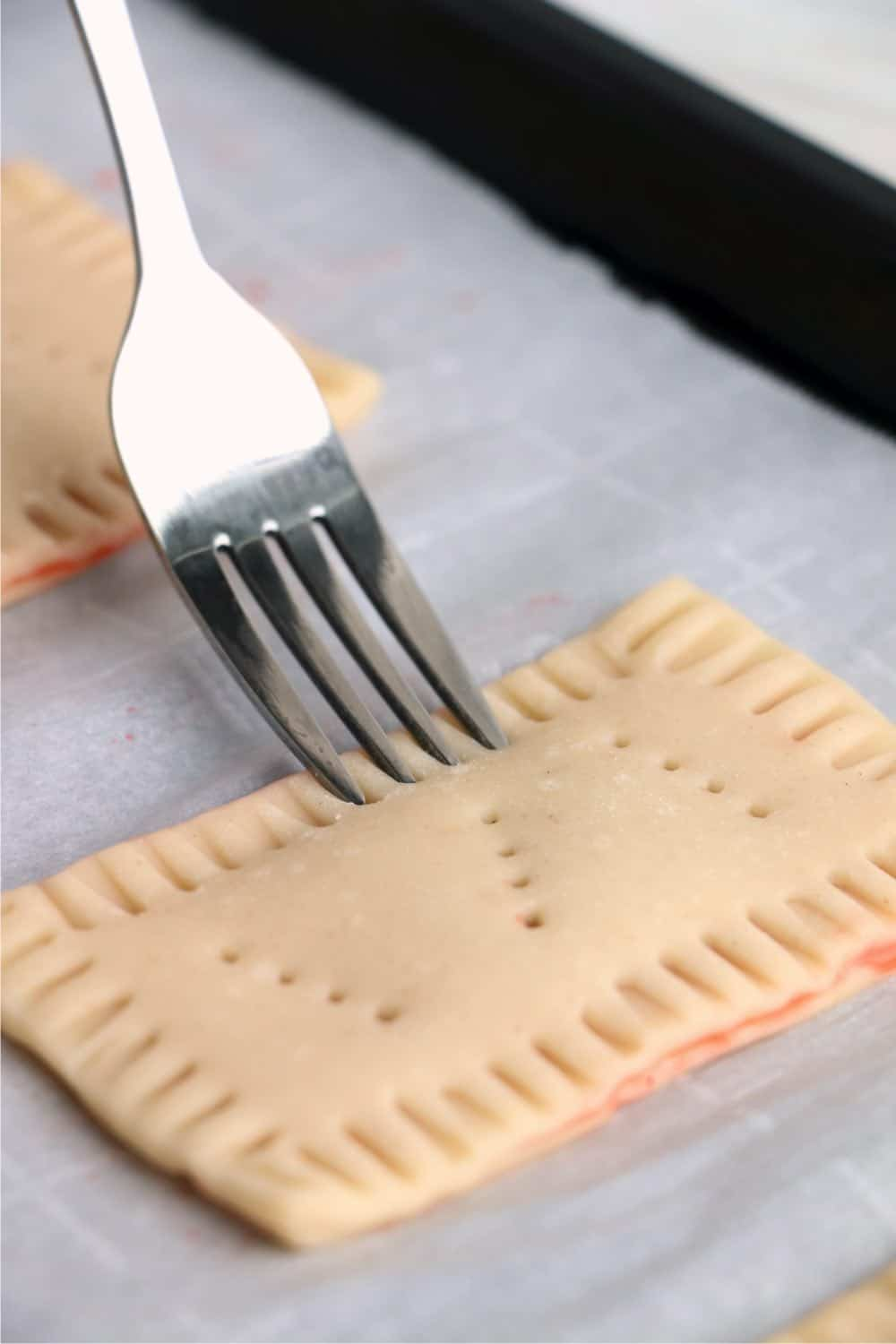 use a fork to poke into the center of each pop tart