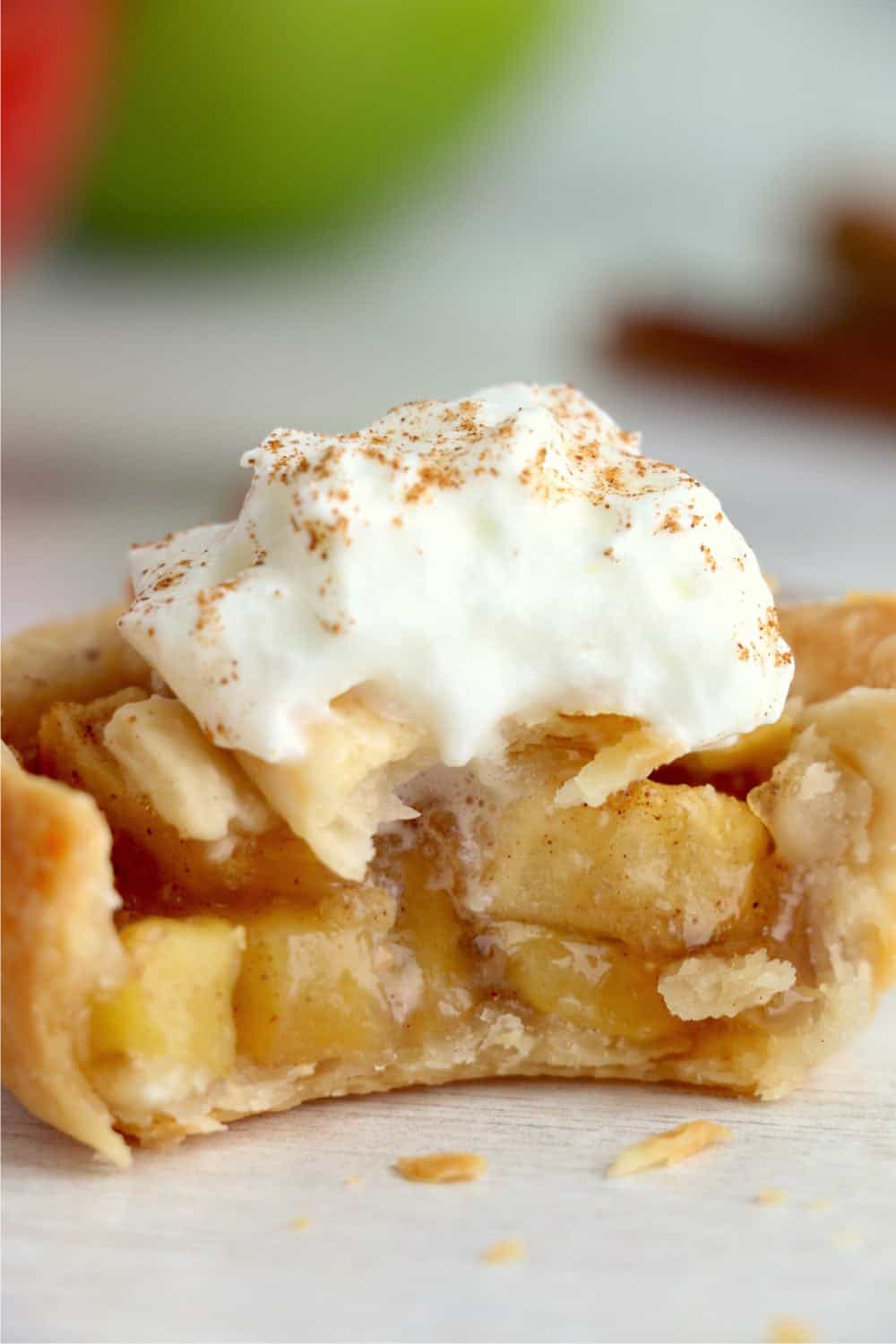 Mini apple pie with whipped cream on top