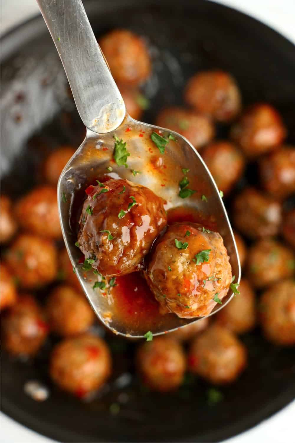 Cooked meatballs smothered in a sweet chili sauce
