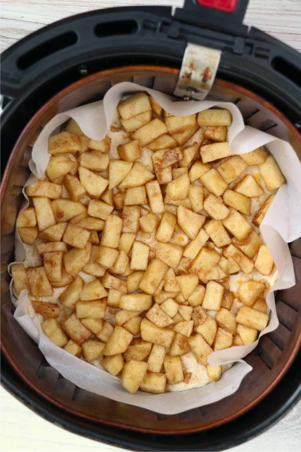 apples being pressed into biscuit layer