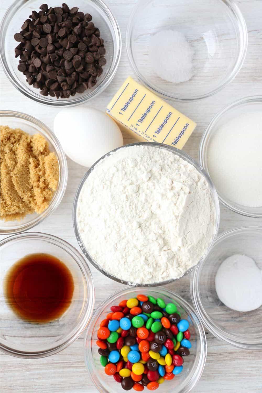 ingredients - butter, sugar, brown sugar, egg, vanilla, flour, baking soda, salt, m&ms, chocolate chips