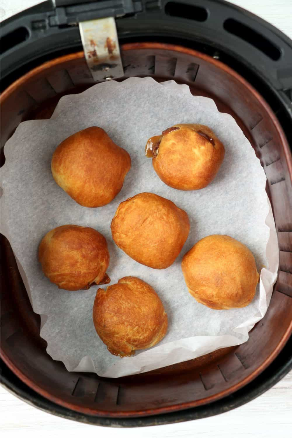 Cooked Snickers covered in biscuit dough in the air fryer