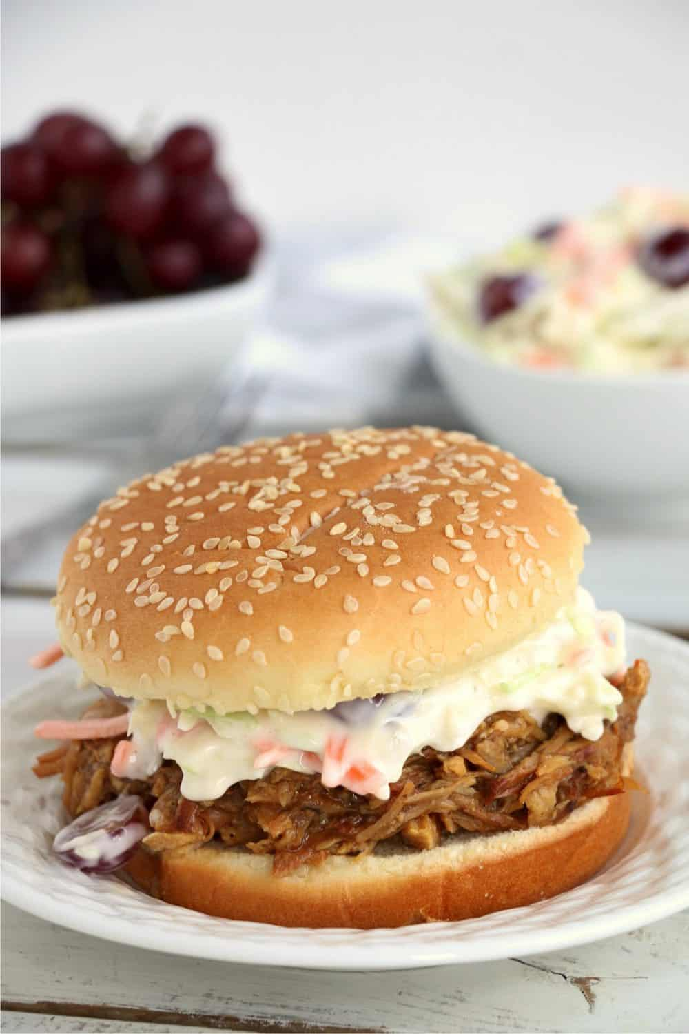 Crock Pot BBQ Pulled Pork on a burger bun and topped with cole slaw