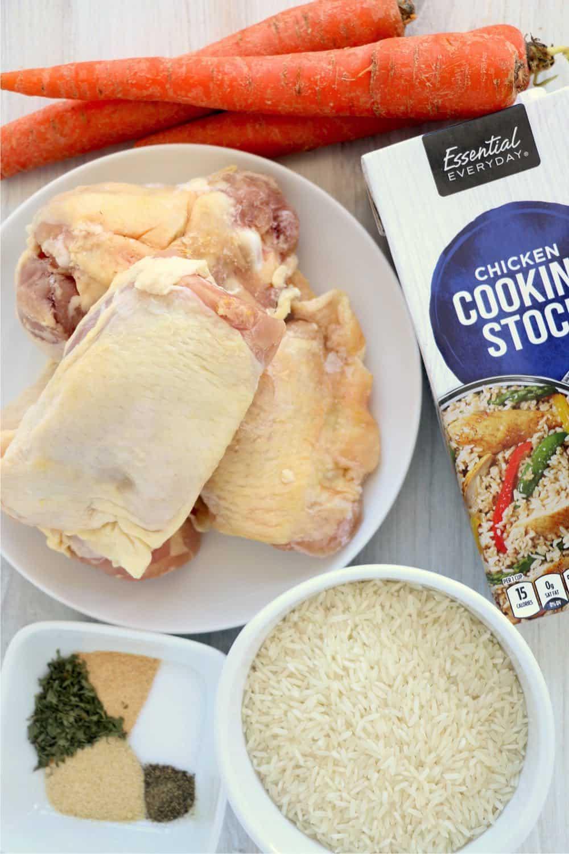 Ingredients needed for instant pot frozen chicken and rice: frozen chicken thighs, jasmine rice, chicken broth, salt, pepper, garlic powder, onion powder, parsley flakes, carrots