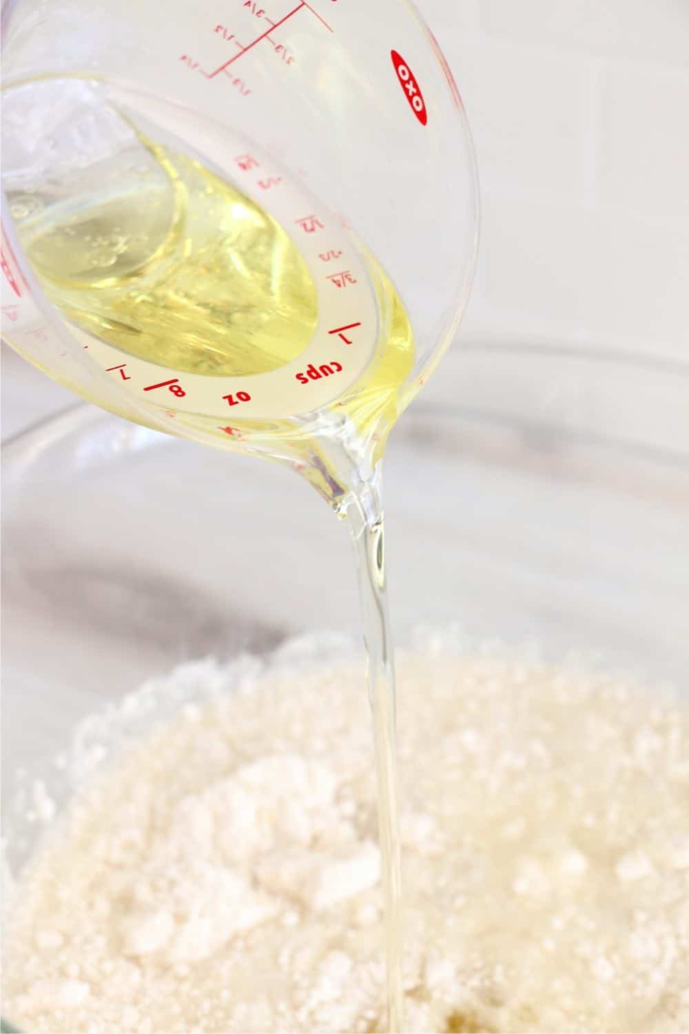 Adding the ingredients together - oil into cake mix
