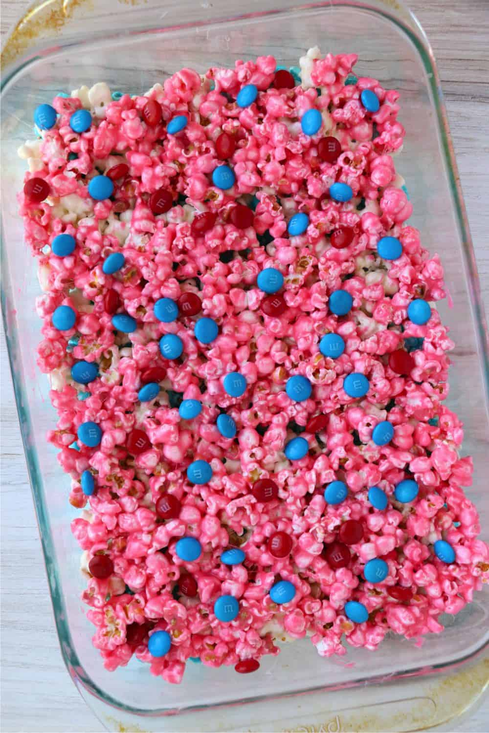 A pan of USA marshmallow cake with red and blue M&Ms sprinkled on top