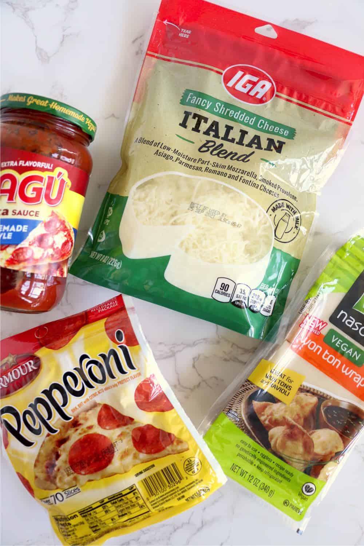 pizza sauce, mozzarella cheese, pepperoni and wonton wrappers.