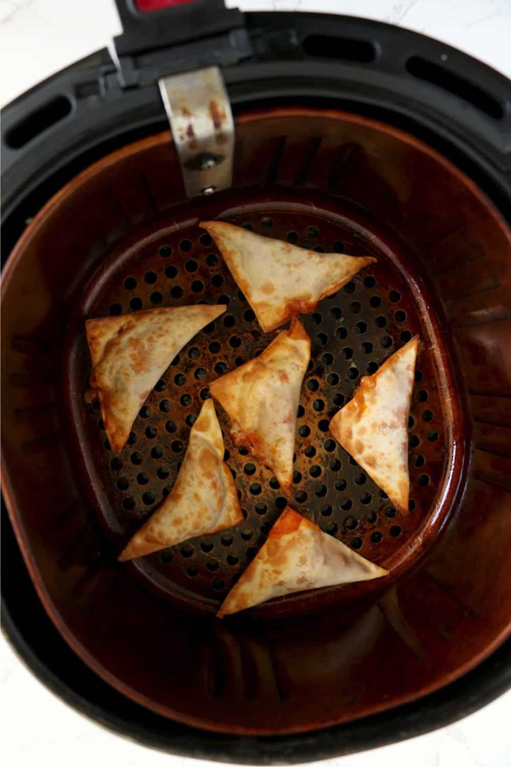 Pizza Rolls in the air fryer after cooking.